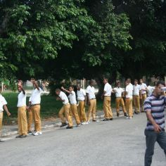 Boys line up for class in typical boy fashion.