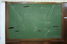 At the National Literacy Museum, artifacts from Cuba's 1960s literacy campaign filled the rooms. This is a chalkboard riddled with bullet holes from the Revolution.