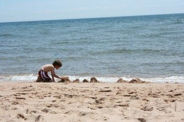 Our son builds castles along Singing Sands Beach
