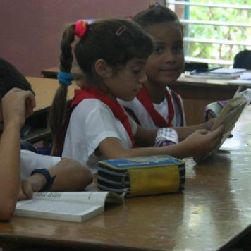 Girls read during the school day.